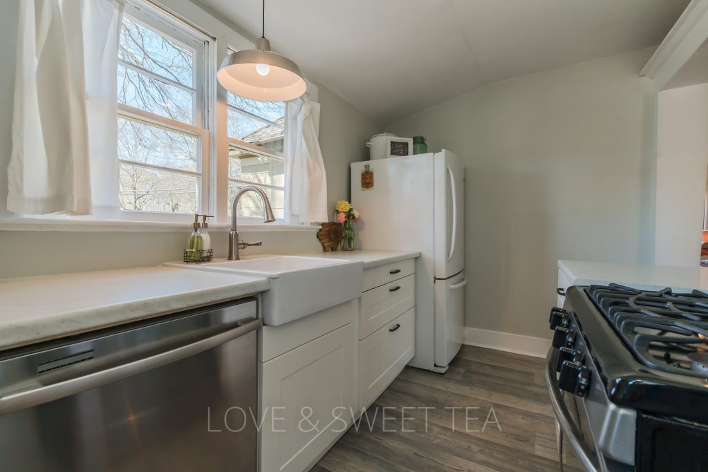 We recently renovated our farmhouse kitchen for under $3000! We shopped all the details and loved our choices in the end for our farmhouse kitchen with sheet vinyl floors, laminate kitchen countertops, and ikea cabinets.